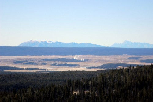 The Hayden Valley (and Mud Volcano) from Mount Washburn. The Grand Tetons 75 miles distant upper right.